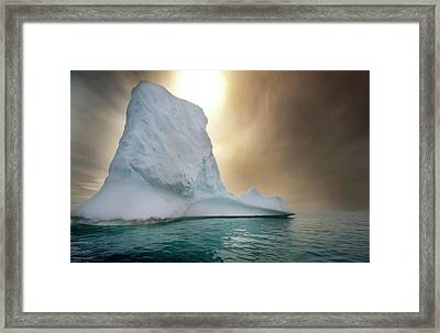 Half Moon Over Island Framed Print by Michael Leggero