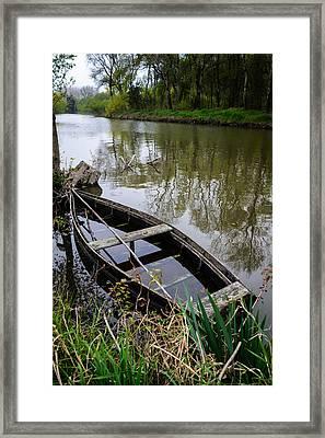 Half Sunken Rowboat Framed Print by Marco Oliveira
