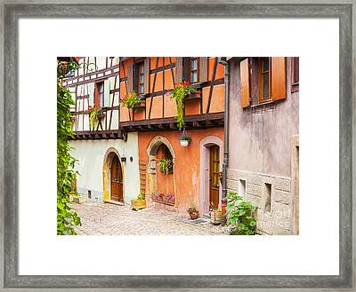 Half-timbered House Of Eguisheim, Alsace, France.  Framed Print by Marco Arduino