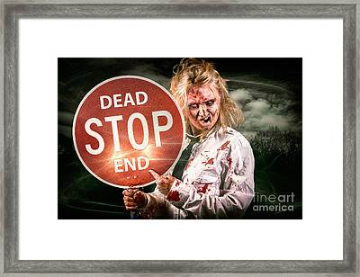 Halloween Portrait. Scary Zombie Holding Stop Sign Framed Print by Jorgo Photography - Wall Art Gallery