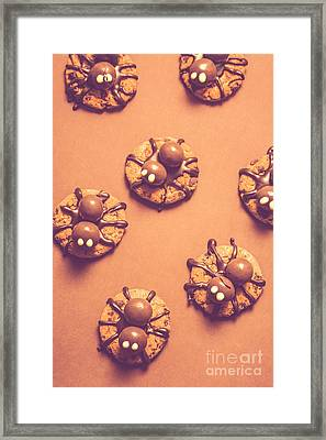 Halloween Spider Cookies On Brown Background Framed Print