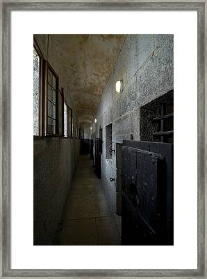 Hallway With Doors To Cells Framed Print by Todd Gipstein