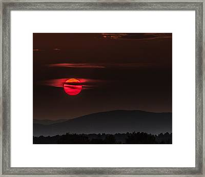 Haloed Sunset Framed Print by Tim Kirchoff