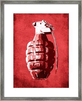Hand Grenade On Red Framed Print by Michael Tompsett