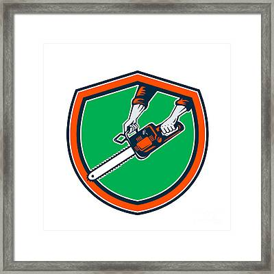 Hand Holding Chainsaw Shield Retro Framed Print