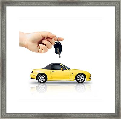 Hand Holding Key To Yellow Sports Car Framed Print by Jorgo Photography - Wall Art Gallery