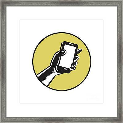 Hand Holding Smartphone Circle Woodcut Framed Print by Aloysius Patrimonio