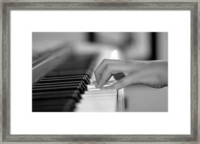Hand On Piano Keyboard Framed Print