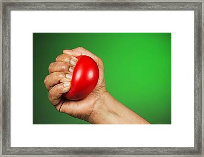 Hand Squeezing Red Stress Ball Framed Print