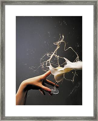 Hand With The Flying Glass Of Liqueur Framed Print