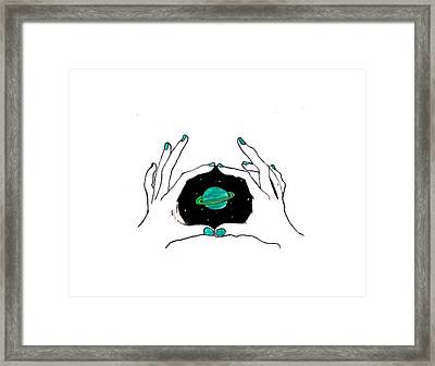 Hands Around Saturn Framed Print by Lucy Frost