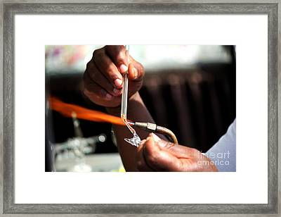 Hands Of The Glassblower Framed Print