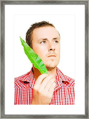 Handsome Man Holding A Green Leaf Framed Print