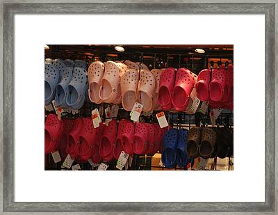 Hanging Crocs Framed Print by Rob Hans