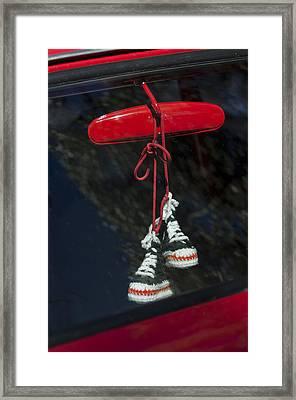 Hanging Hightops Framed Print by Jill Reger