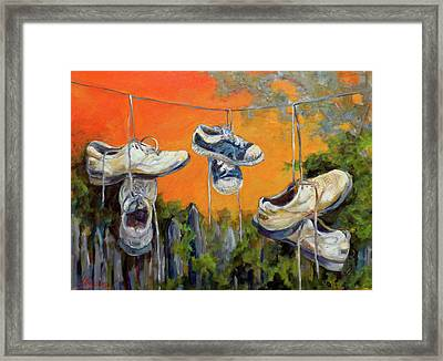 Hanging Tennis Shoes Framed Print by Jean Groberg