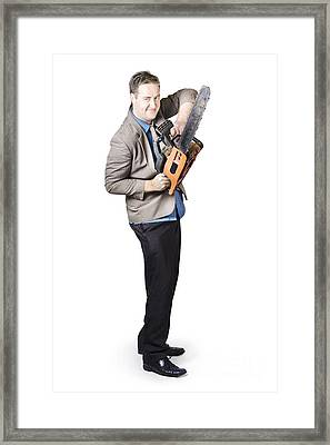 Happy Businessman Holding Chainsaw Framed Print by Jorgo Photography - Wall Art Gallery
