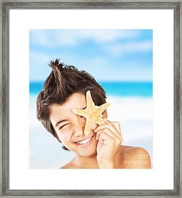 Happy Face Boy With Starfish On The Beach Framed Print by Anna Om