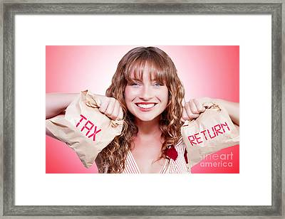 Happy Female Accountant Holding Income Tax Return Framed Print by Jorgo Photography - Wall Art Gallery