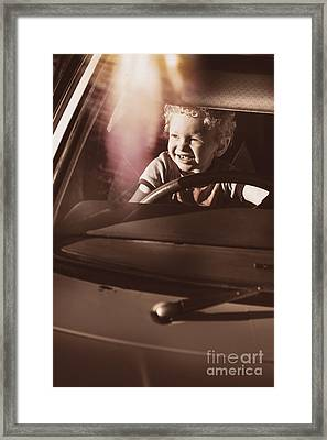 Happy Kid Pretending To Drive Vintage Car Framed Print