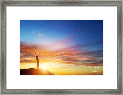 Happy Man With Hands Up On Peak Of The Mountain At Sunset Framed Print