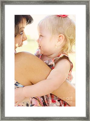 Happy Mother Holding Baby With Look Of Surprise Framed Print
