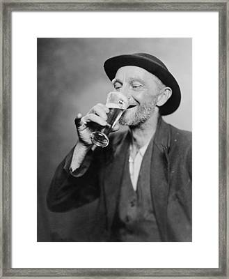 Happy Old Man Drinking Glass Of Beer Framed Print by Everett