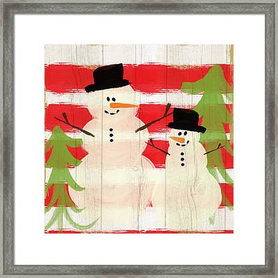 Happy Snowmen- Art By Linda Woods Framed Print by Linda Woods