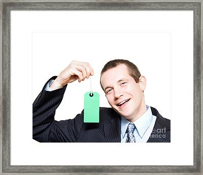 Happy Store Sales Man With Blank Price Tag Framed Print by Jorgo Photography - Wall Art Gallery