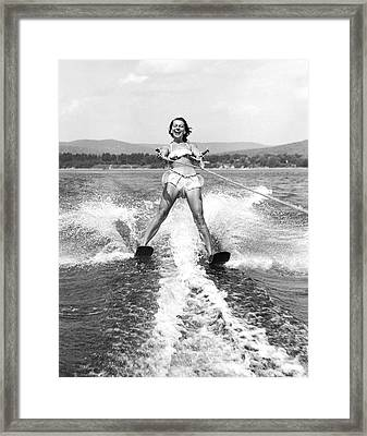 Happy Woman Water Skier Framed Print by Underwood Archives