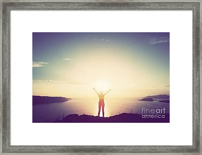Happy Woman With Hands Up On Cliff Over Sea And Islands At Sunset Framed Print by Michal Bednarek