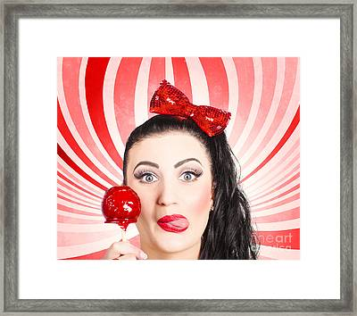 Happy Young Retro Woman With Lollipop Toffee Apple Framed Print by Jorgo Photography - Wall Art Gallery