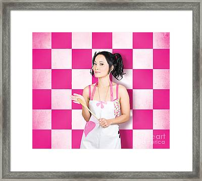 Happy Young Woman Cooking With Wooden Spoon Framed Print by Jorgo Photography - Wall Art Gallery