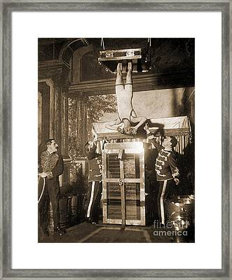Harry Houdini Suspended Above A Tank Of Water  Framed Print