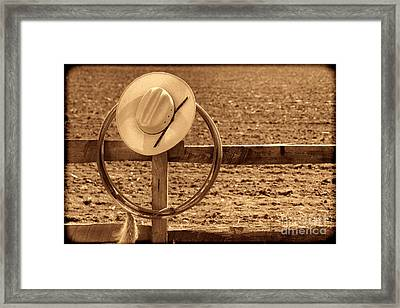 Hat And Lasso On A Fence Framed Print