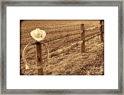 Hat And Lasso On Fence Framed Print
