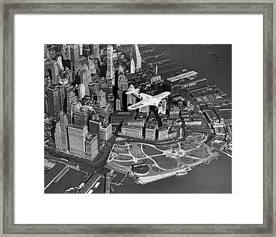 Hawk's Plane Over Battery Park Framed Print by Underwood Archives