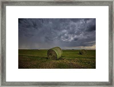 Hay Bales And Rain  Framed Print