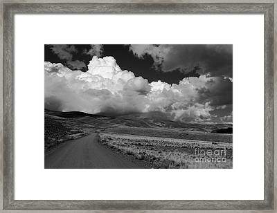 Heading Towards The Storm Framed Print by James Brunker