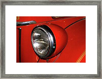 Headlamp On Red Firetruck Framed Print by Douglas Barnett