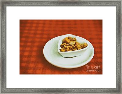 Heart Shaped Bowl With Dried Hard Fruits And Peanuts Framed Print by Radu Bercan