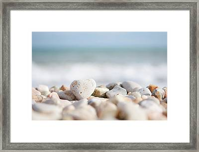 Heart Shaped Pebble On The Beach Framed Print by Alexandre Fundone