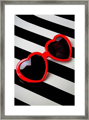 Heart Shaped Sunglasses Framed Print by Garry Gay