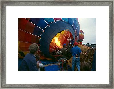 Heating The Envelope Framed Print by Bonnie Muir