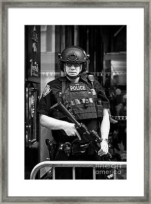 heavily armed nypd protective security detail outside trump tower manhattan New York City USA Framed Print by Joe Fox