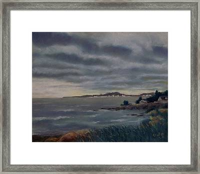 Heavy Clouds Over Rye Framed Print by Marcus Moller