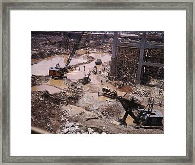 Heavy Equipment In The Mud Of Tennessee Framed Print by Everett