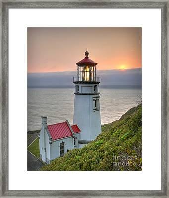 Heceta Lighthouse At Sunset Framed Print by Martin Konopacki