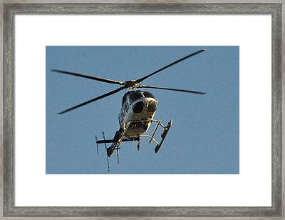 Helicopter On Final Approach  Framed Print by Bill Perry