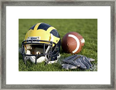 Helmet On The Field With Football And Gloves Framed Print